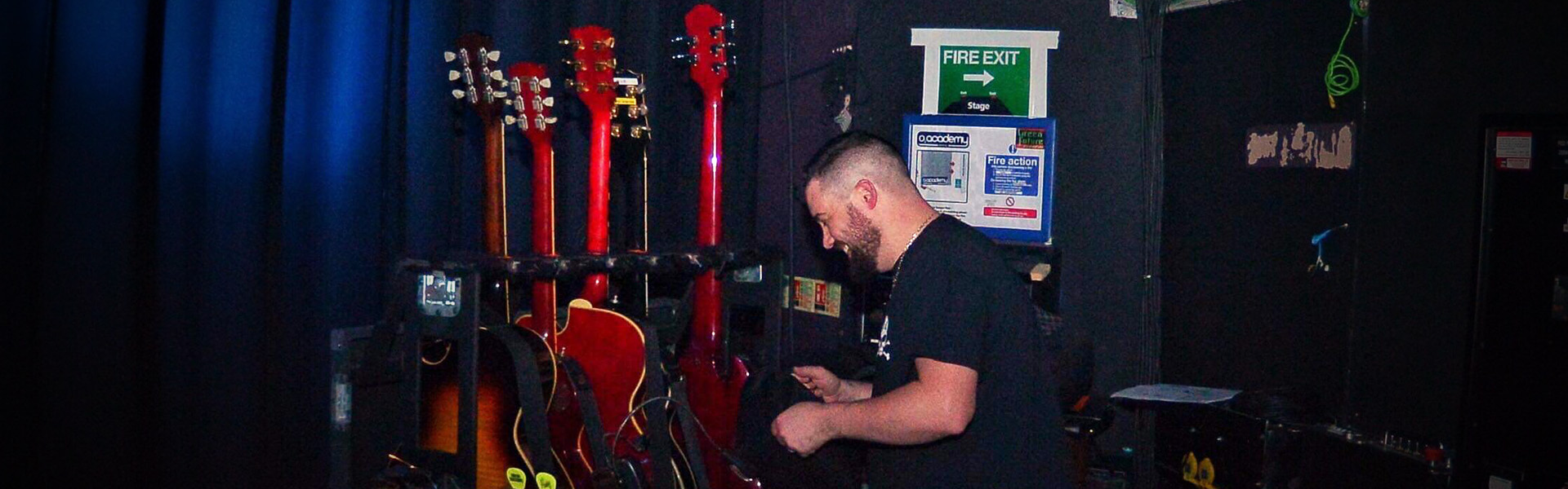 Brendon Riley of Shire Guitars working backstage at O2 Academy. Pic courtesy of Perry Smylie Photography